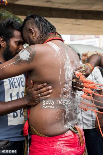 Tamilians sharply pierced with an iron beak sharply while celebrating Thaipusam festival in Batu caves on February 04 2017 in Kuala Lumpur Malaysia...