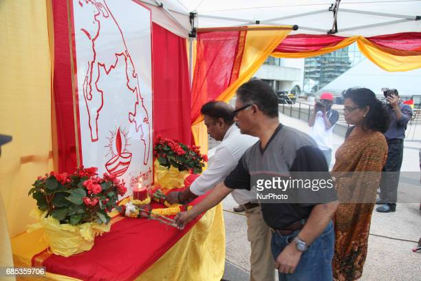 Tamils lay flowers at a makeshift memorial during Tamil Genocide Remembrance Day on May 18 2017 in Scarborough Ontario Canada Tamils gathered to...
