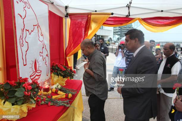 Tamils offer their prayers at a makeshift memorial during Tamil Genocide Remembrance Day on May 18 2017 in Scarborough Ontario Canada Tamils gathered...