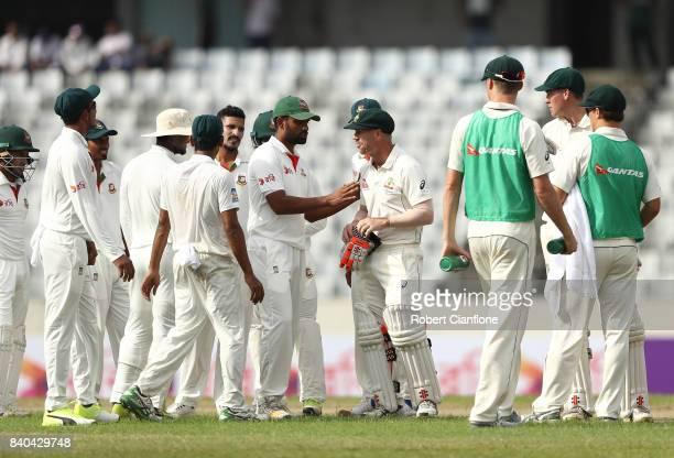 Tamim Iqbal Khan of Bangladesh and David Warner of Australia exchange words during day three of the First Test match between Bangladesh and Australia...
