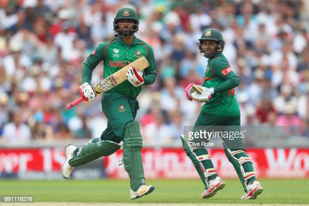 Tamim Iqbal Khan of Bangladesh and Mushfiqur Rahim of Bangladesh run between the wickets during the ICC Champions Cup Group A match between England...