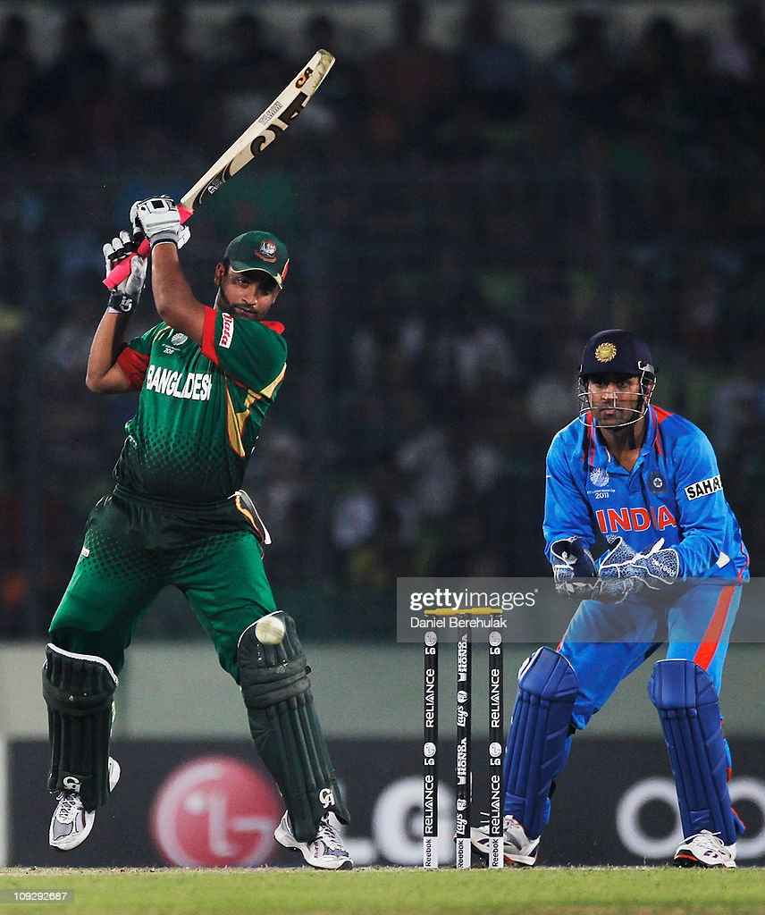 <a gi-track='captionPersonalityLinkClicked' href=/galleries/search?phrase=Tamim+Iqbal&family=editorial&specificpeople=4181226 ng-click='$event.stopPropagation()'>Tamim Iqbal</a> of Bangladesh bats as captain MS Dhoni of India looks on during the opening game of the ICC Cricket World Cup between Bangladesh and India at the Shere-e-Bangla National Stadium on February 19, 2011 in Dhaka, Bangladesh.