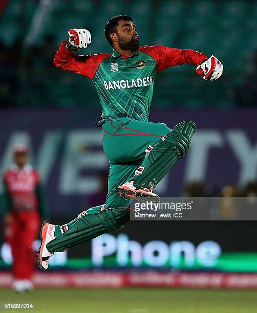 Tamim Iqbal of Bangladesh celebrates his century during the ICC World Twenty20 India 2016 match between Bangladesh and Oman at the HPCA Stadium on...