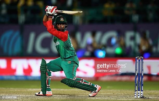 Tamim Iqbal of Bangladesh hits the ball towards the boundary during the ICC World Twenty20 India 2016 match between Bangladesh and Oman at the HPCA...