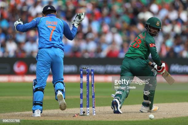 Tamim Iqbal of Bangladesh looks back as he is bowled off the bowling of Kedar Jadhav during the ICC Champions Trophy SemiFinal match between...