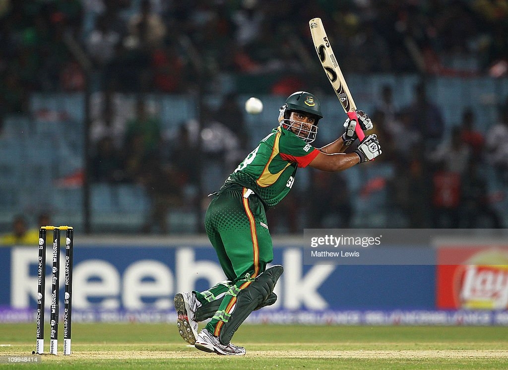 <a gi-track='captionPersonalityLinkClicked' href=/galleries/search?phrase=Tamim+Iqbal&family=editorial&specificpeople=4181226 ng-click='$event.stopPropagation()'>Tamim Iqbal</a> of Bangladesh pulls the ball towards the boundary during the 2011 ICC World Cup Group B match between Bangladesh and England at Zohur Ahmed Chowdhury Stadium on March 11, 2011 in Chittagong, Bangladesh.