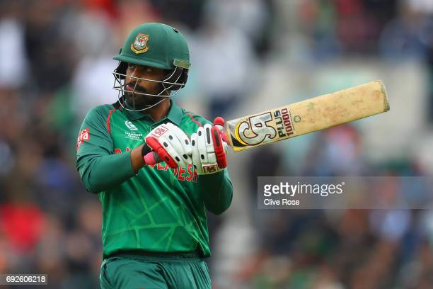 Tamim Iqbal of Bangladesh swipes the air with his bat after being dismissed just short of his century during the ICC Champions trophy cricket match...