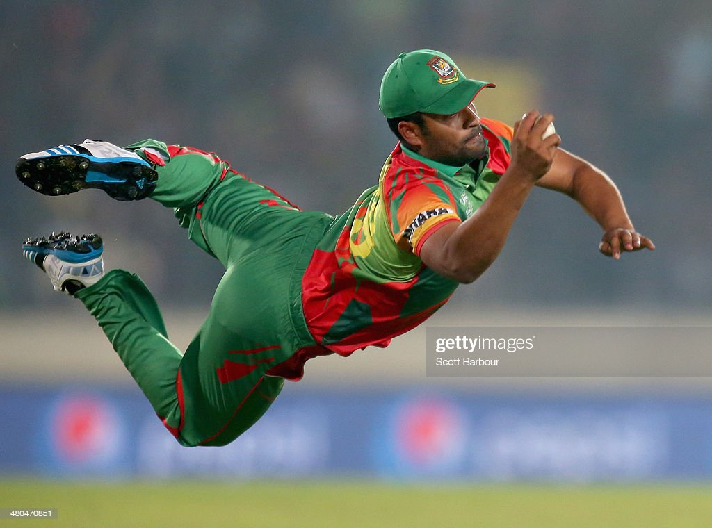 <a gi-track='captionPersonalityLinkClicked' href=/galleries/search?phrase=Tamim+Iqbal&family=editorial&specificpeople=4181226 ng-click='$event.stopPropagation()'>Tamim Iqbal</a> of Bangladesh takes a diving catch to dismiss Dwayne Bravo of the West Indies during the ICC World Twenty20 Bangladesh 2014 match between Bangladesh and the West Indies at Sher-e-Bangla Mirpur Stadium on March 25, 2014 in Dhaka, Bangladesh.