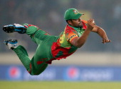Tamim Iqbal of Bangladesh takes a diving catch to dismiss Dwayne Bravo of the West Indies during the ICC World Twenty20 Bangladesh 2014 match between...