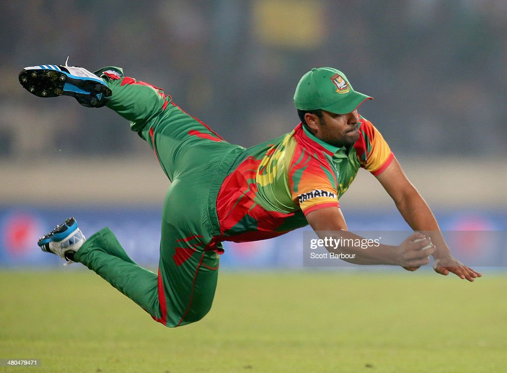 Tamim Iqbal of Bangladesh takes a diving catch to dismiss Dwayne Bravo of the West Indies during the ICC World Twenty20 Bangladesh 2014 match between Bangladesh and the West Indies at Sher-e-Bangla Mirpur Stadium on March 25, 2014 in Dhaka, Bangladesh.
