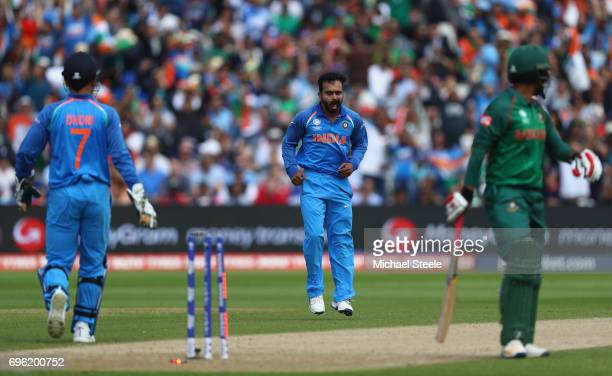 Tamim Iqbal of Bangladesh walks as he is bowled off the bowling of Kedar Jadhav of India during the ICC Champions Trophy SemiFinal match between...