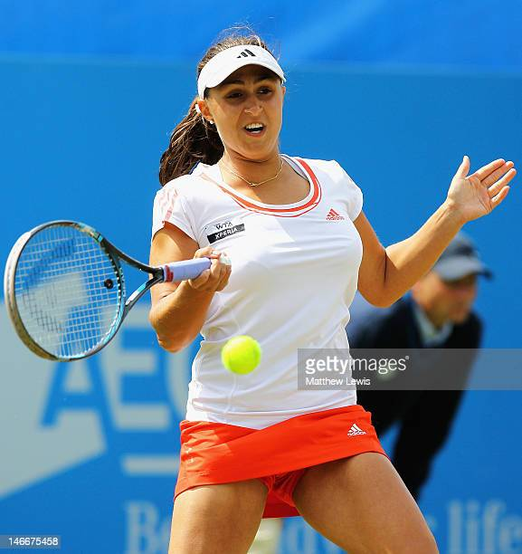 Tamira Paszek of Austria in action against Marion Bartoli of France during the Womens SemiFinal match of day seven of the AEGON International on June...
