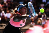 Tamira Paszek of Austria plays a forehand against Jamie Hampton of the USA during day one of the ASB Classic at ASB Tennis Centre on December 30 2013...