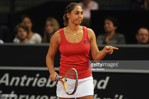 Tamira Paszek of Austria points during her first round match against Andrea Petkovic of Germany at the Porsche Tennis Grand Prix at Porsche Arena on...