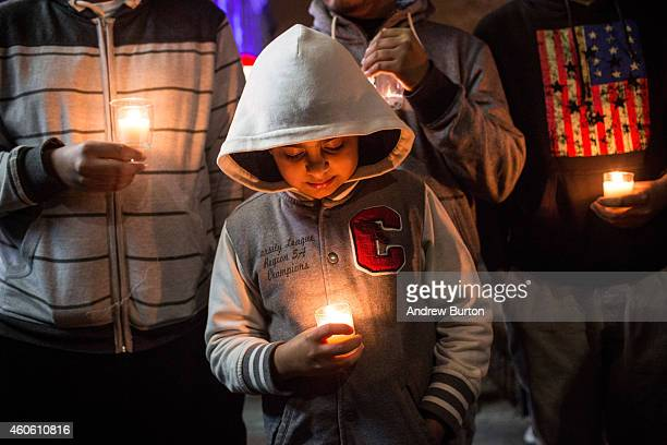 Tamjeed Malik age 8 attends a candlelight vigil for the 132 students killed in a terror attack yesterday in Pakistan on December 17 2014 in the...