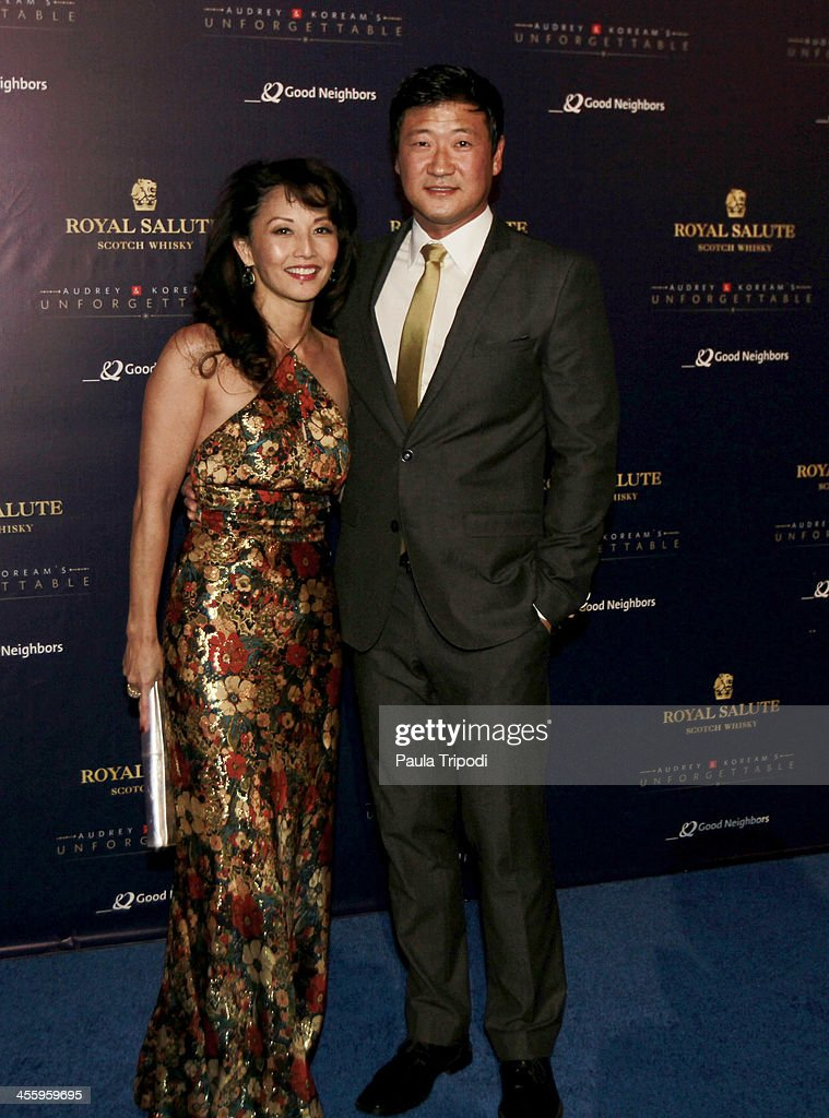 Tamlyn Tomita and Tom Choi arrive at Park Plaza on December 7, 2013 in Los Angeles, California.