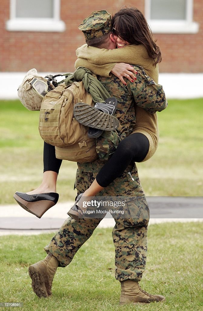 Tammie Pappas greets Lance Corporal Benjamin Mastrofilippo as he returns December 3 2006 to Camp Lejeune North Carolina The 2200 Marines and Sailors...