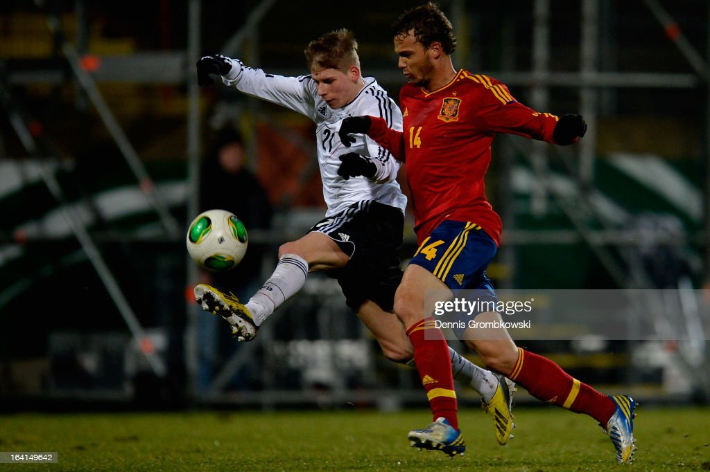 Tammo Harder of Germany is challenged by Pablo Iniguez of Spain during the International Friendly match between U19 Germany and U19 Spain on March 20, 2013 in Duesseldorf, Germany.