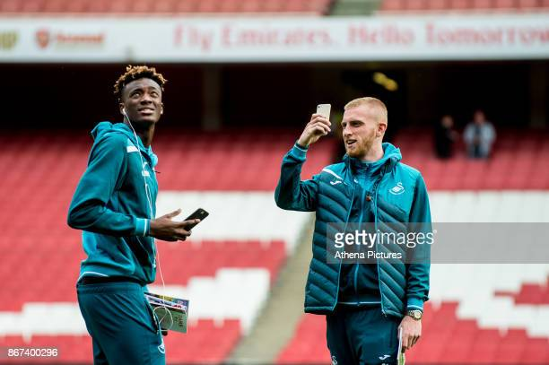 Tammy Abraham and Oliver McBurnie inspect the pitch ahead of the Premier League match between Arsenal and Swansea City at Emirates stadium on October...