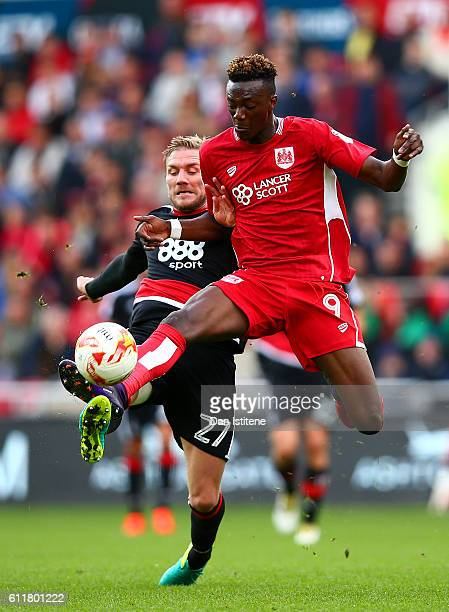 Tammy Abraham of Bristol City battles for the ball with Damien Perquis of Nottingham Forest during the Sky Bet Championship match between Bristol...