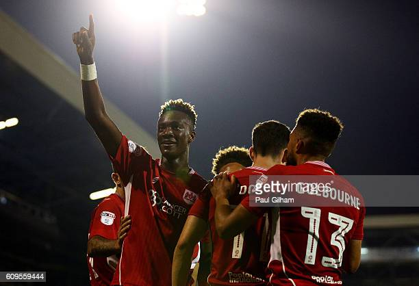 Tammy Abraham of Bristol City celebrates scoring his sides second goal with team mates during the EFL Cup Third Round match between Fulham and...