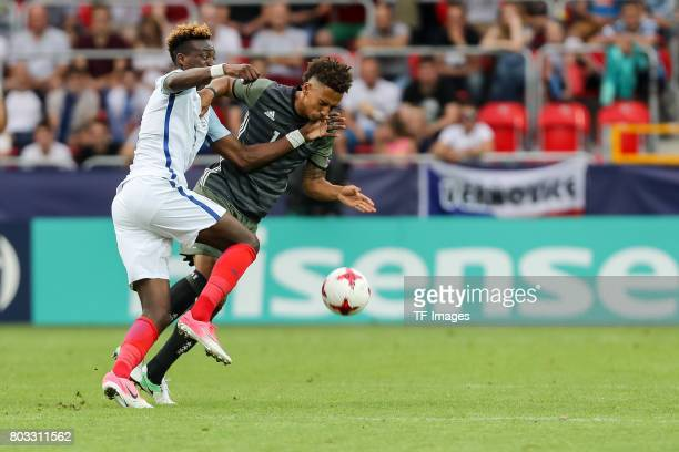 Tammy Abraham of England and Thilo Kehrer of Germany battle for the ball during the UEFA European Under21 Championship Semi Final match between...