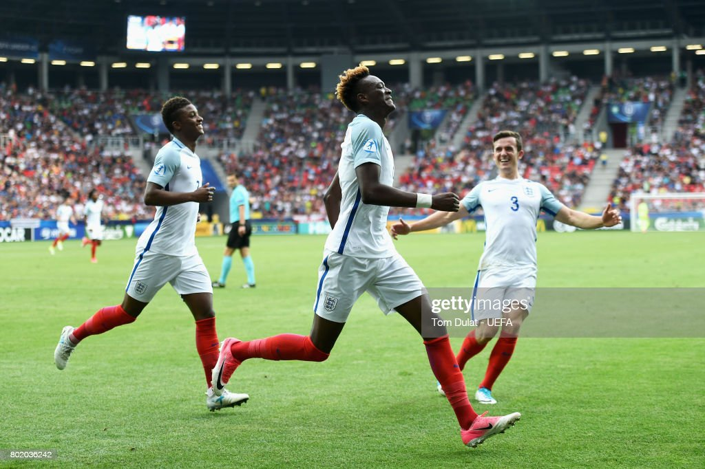 Tammy Abraham of England celebrates scoring his sides second goal with Demarai Gray of England and Ben Chilwell of England during the UEFA European Under-21 Championship Semi Final match between England and Germany at Tychy Stadium on June 27, 2017 in Tychy, Poland.