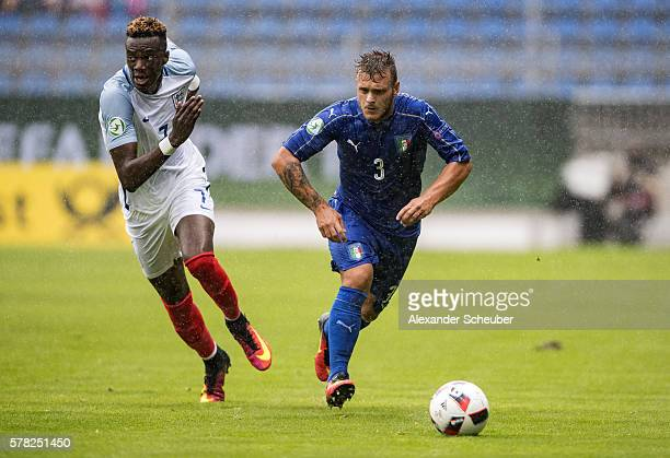 Tammy Abraham of England challenges Federico Dimarco of Italy uring the U19 Match between England and Italy at CarlBenzStadium on July 21 2016 in...