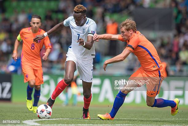 Tammy Abraham of England is challenged by Hidde ter Avest of the Netherlands during the UEFA Under19 European Championship match between U19...