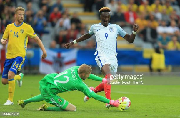 Tammy Abraham of England takes on goalkeeper Anton Cajtoft of Sweden during the UEFA European Under21 Championship match between Sweden and England...