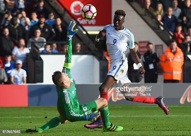 Tammy Abraham of England U21 beats goalkeeper Kenan Piric of Bosnia and Herzegovina U21 to score their fifth goal during the UEFA European U21...
