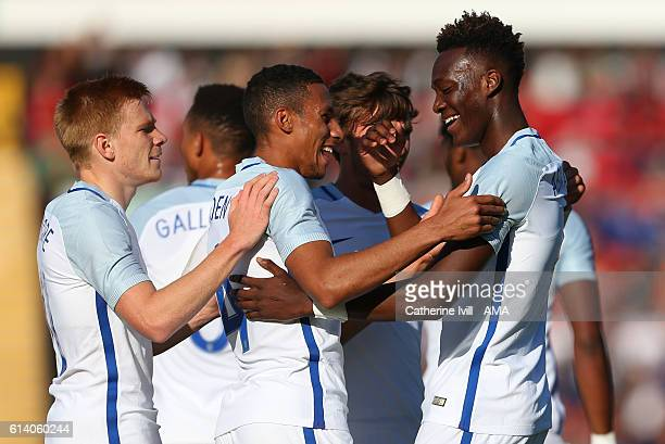 Tammy Abraham of England U21 celebrates with Isaac Hayden and Duncan Watmore of England U21 during the UEFA European U21 Championship Group 9...