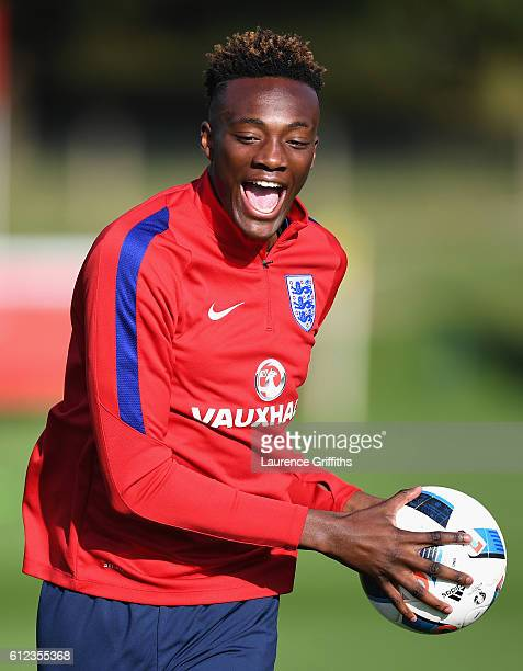 Tammy Abraham of England U21 is all smiles during a training session at St Georges Park on October 4 2016 in BurtonuponTrent England