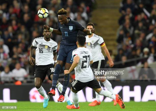 Tammy Abraham of England wins a header over IIkay Gundogan of Germany during the International friendly match between England and Germany at Wembley...