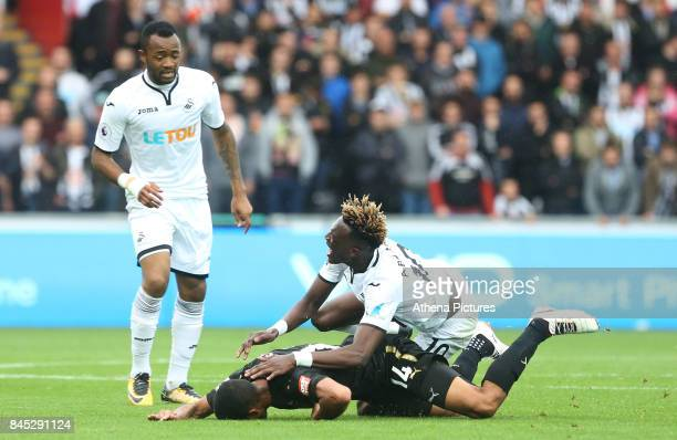 Tammy Abraham of Swansea City and Isaac Hayden of Newcastle United collide during the Premier League match between Swansea City and Newcastle United...