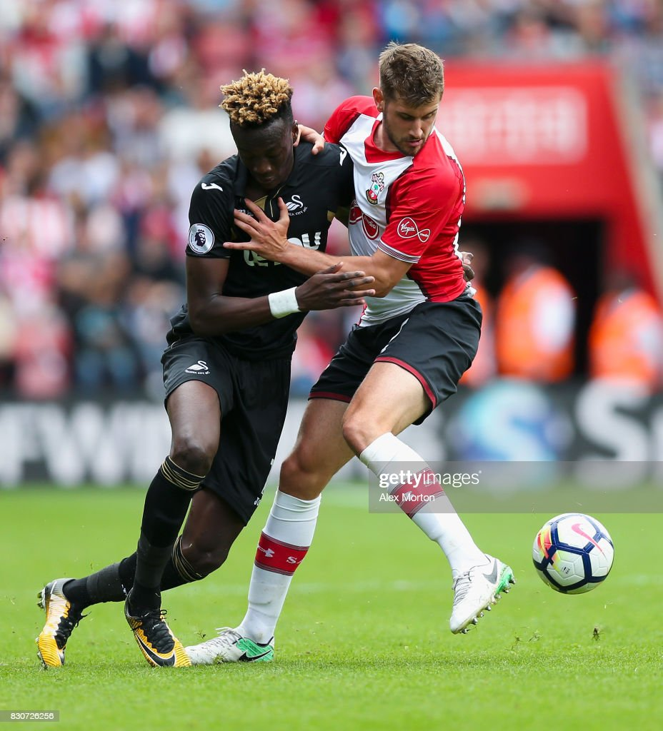Tammy Abraham of Swansea City and Jack Stephens of Southampton battle for possession during the Premier League match between Southampton and Swansea City at St Mary's Stadium on August 12, 2017 in Southampton, England.