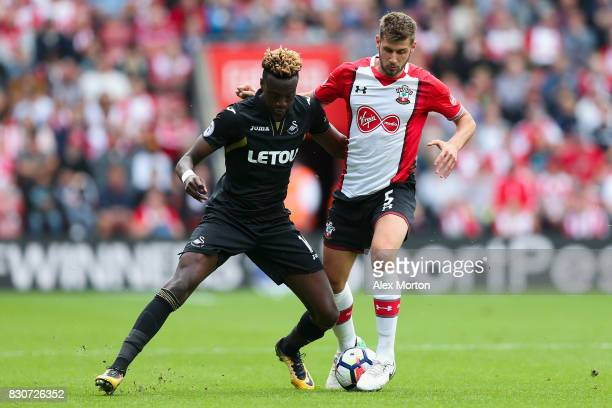 Tammy Abraham of Swansea City and Jack Stephens of Southampton battle for possession during the Premier League match between Southampton and Swansea...