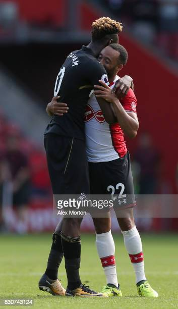 Tammy Abraham of Swansea City and Nathan Redmond of Southampton embrace after the Premier League match between Southampton and Swansea City at St...