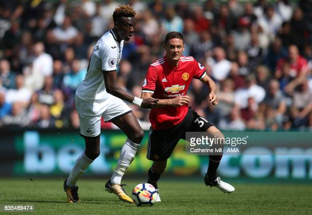 Tammy Abraham of Swansea City and Nemanja Matic of Manchester United during the Premier League match between Swansea City and Manchester United at...