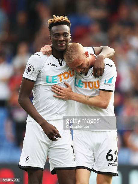 Tammy Abraham of Swansea City and Oliver McBurnie of Swansea City celebrate victory after the Premier League match between Crystal Palace and Swansea...
