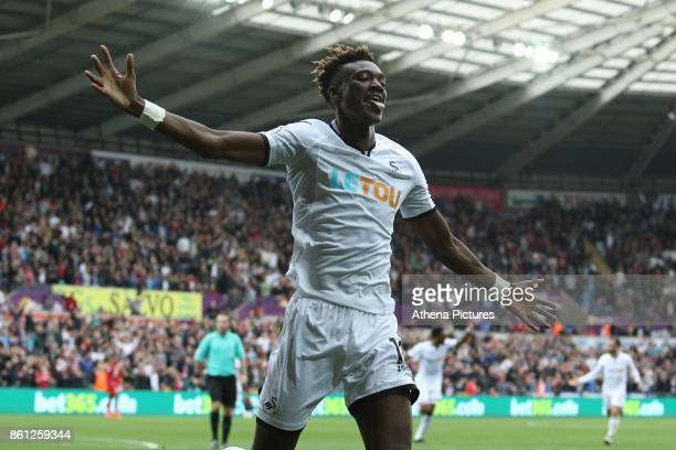 Tammy Abraham of Swansea City and Tom Carroll celebrates scoring his sides first goal of the match during the Premier League match between Swansea...