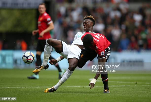Tammy Abraham of Swansea City battles with Eric Bailly of Manchester United during the Premier League match between Swansea City and Manchester...