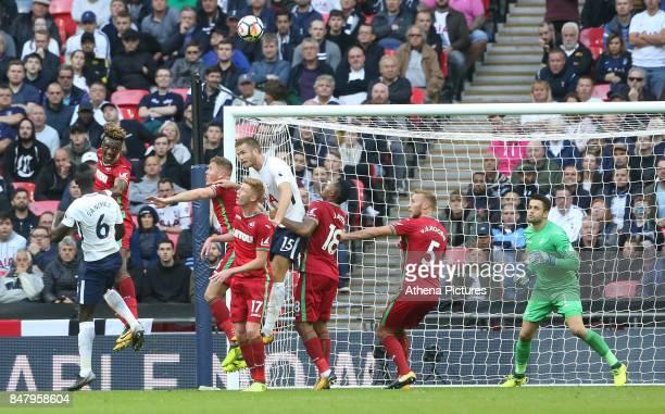 Tammy Abraham of Swansea City beats Davinson Sanchez of Tottenham Hotspur to the header during the Premier League match between Tottenham Hotspur and...