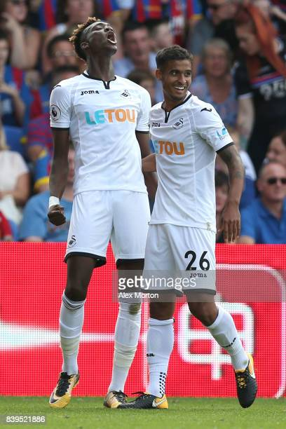 Tammy Abraham of Swansea City celebrates scoring his sides first goal with Kyle Naughton of Swansea City during the Premier League match between...
