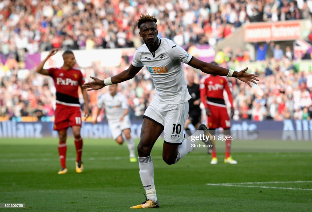 Tammy Abraham of Swansea City celebrates scoring his side's first goal during the Premier League match between Swansea City and Watford at Liberty Stadium on September 23, 2017 in Swansea, Wales.