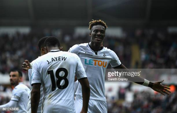 Tammy Abraham of Swansea City celebrates scoring his sides first goal during the Premier League match between Swansea City and Huddersfield Town at...