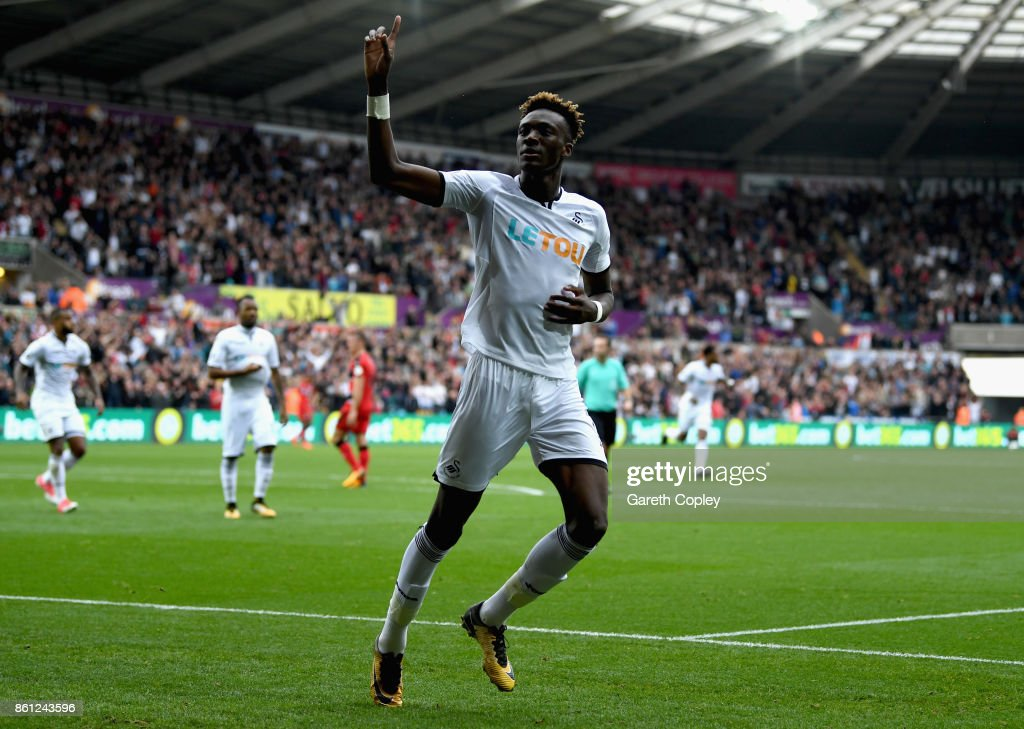 Tammy Abraham of Swansea City celebrates scoring his sides first goal during the Premier League match between Swansea City and Huddersfield Town at Liberty Stadium on October 14, 2017 in Swansea, Wales.