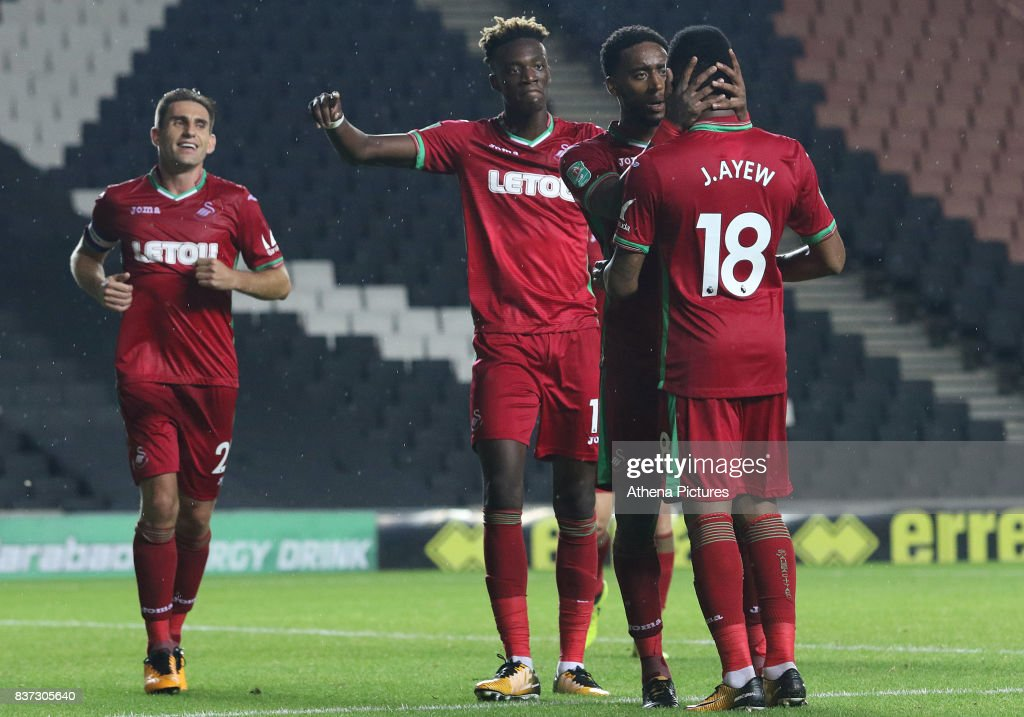 Tammy Abraham of Swansea City celebrates scoring his sides third goal of the match with Leroy For and Jordan Ayew during the Carabao Cup Second Round match between MK Dons and Swansea City at StadiumMK on August 22, 2017 in Milton Keynes, England.