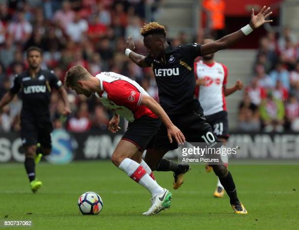 Tammy Abraham of Swansea City challenged by Jack Stephens of Southampton during the Premier League match between Southampton and Swansea City at the...