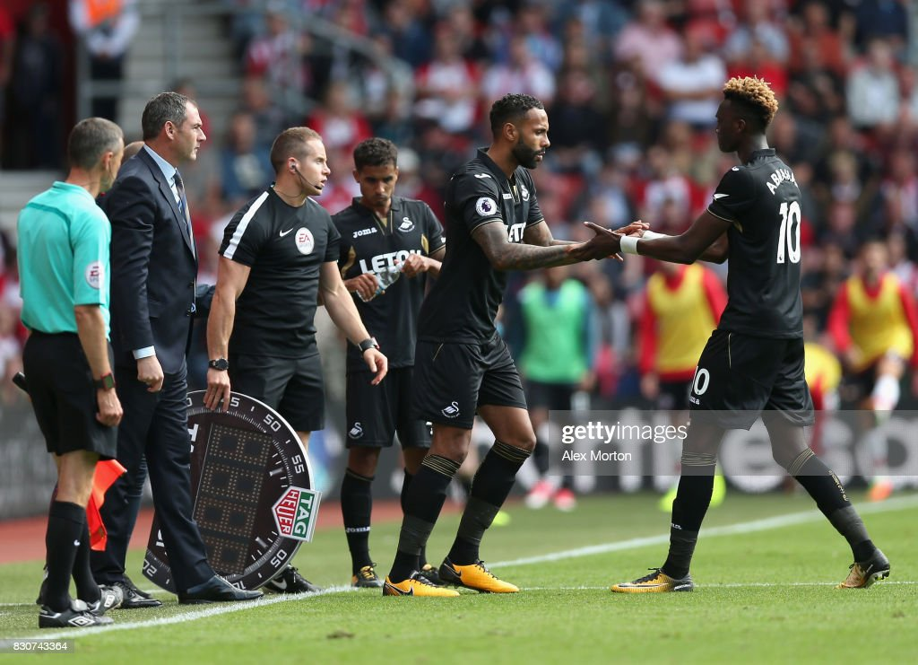 Tammy Abraham of Swansea City comes off for Kyle Bartley of Swansea City during the Premier League match between Southampton and Swansea City at St Mary's Stadium on August 12, 2017 in Southampton, England.